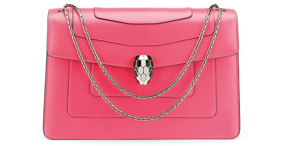 Serpenti Forever flap cover bag in reef coral calf leather with brass light gold plated chain and snakehead closure.