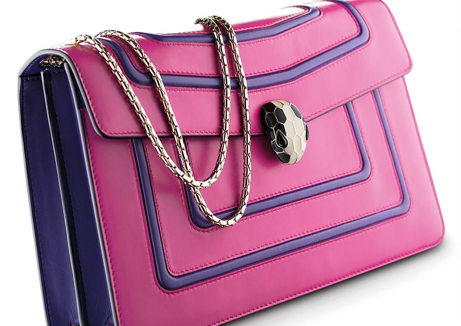 Bulgari Serpenti Forever flap cover bag in berry tourmaline calf leather featuring the graphic frame motif in violet amethyst calf leather with brass light gold plated chain and snakehead closure in black and white enamel with black onyx eyes.