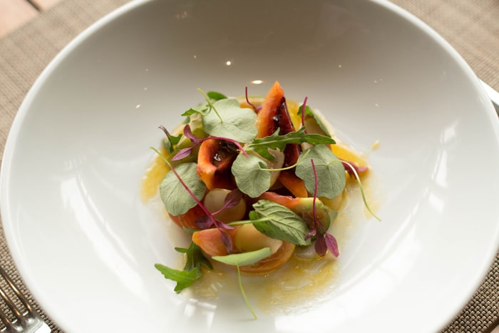 Heirloom tomato salad, local wild potato, passion fruit vinaigrette from Chef Olivier Deboise Mendez from J&G Grill at St. Regis Hotel in Mexico City
