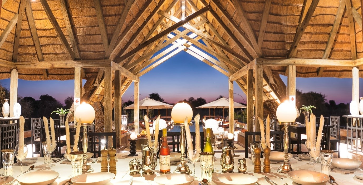 Dinner is served with views of the sunset over the Kalahari landscape.
