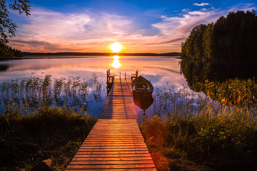 Sunset over the fishing pier at the lake in rural Finland