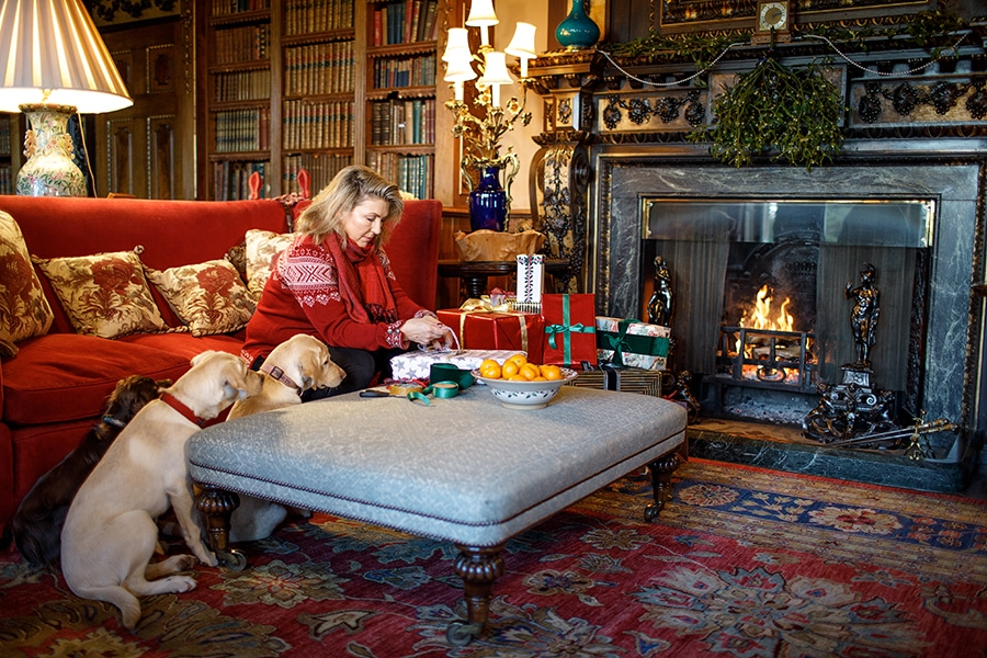 The countess of Carnarvon wrapping presents at Highclere Castle
