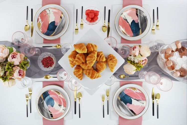 When the girls get together, everything comes up rosé. Whether hosting a ladies' lunch, gossip sesh, or birthday bash, these bold painted plates, black and gold flatware, and pink-hued napkins and glassware will be your entertaining BFFs.
