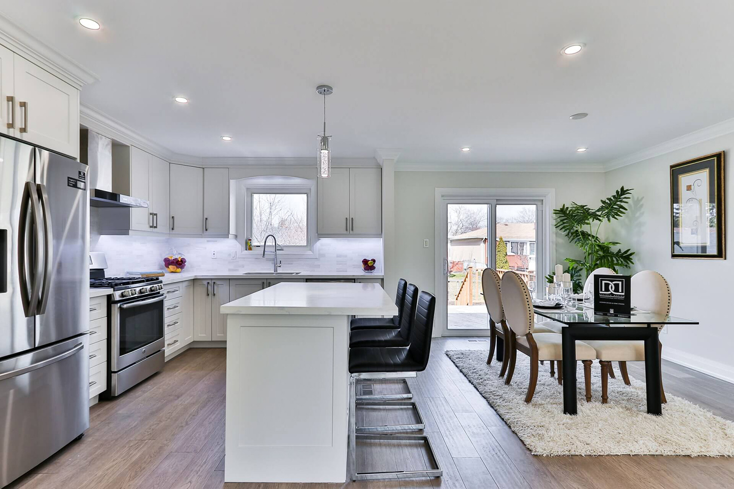 beautifully designed kitchen with classy dining furniture