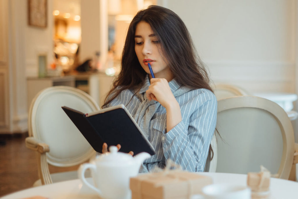 woman reading her essay writing