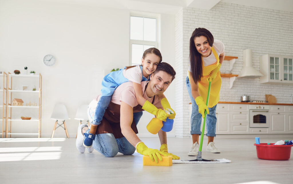 Funny family cleans the room in the house.