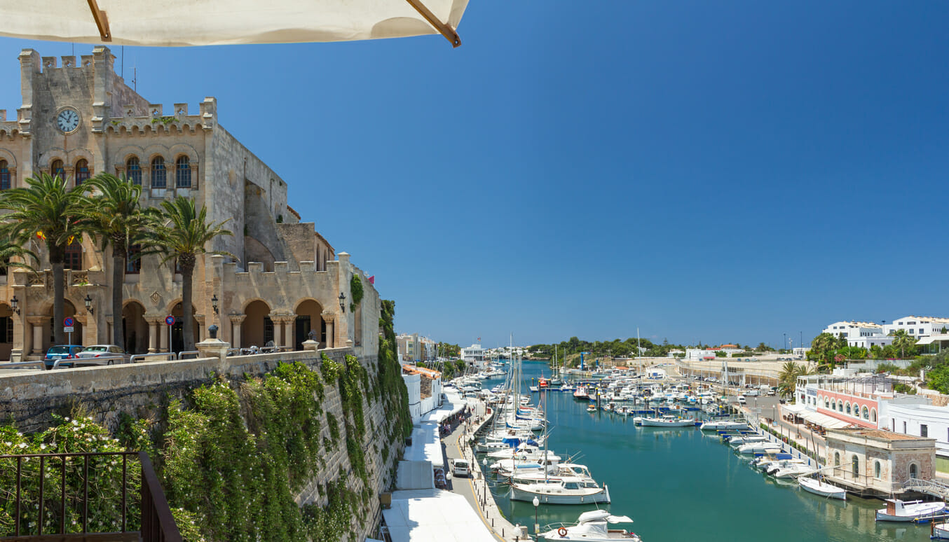 View from the town hall down into the small harbor at the west end of the island of Menorca.