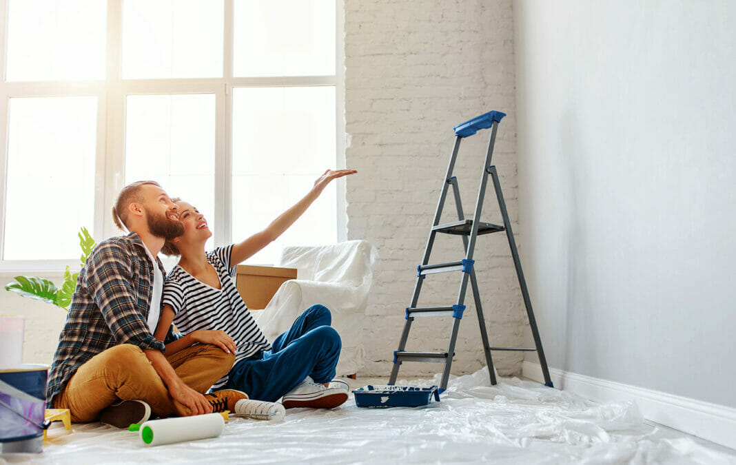 young happy family married couple dreams of renovating house and planning design project