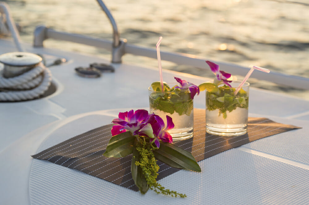 Two beautiful cocktails on a yacht in the sea at sunset