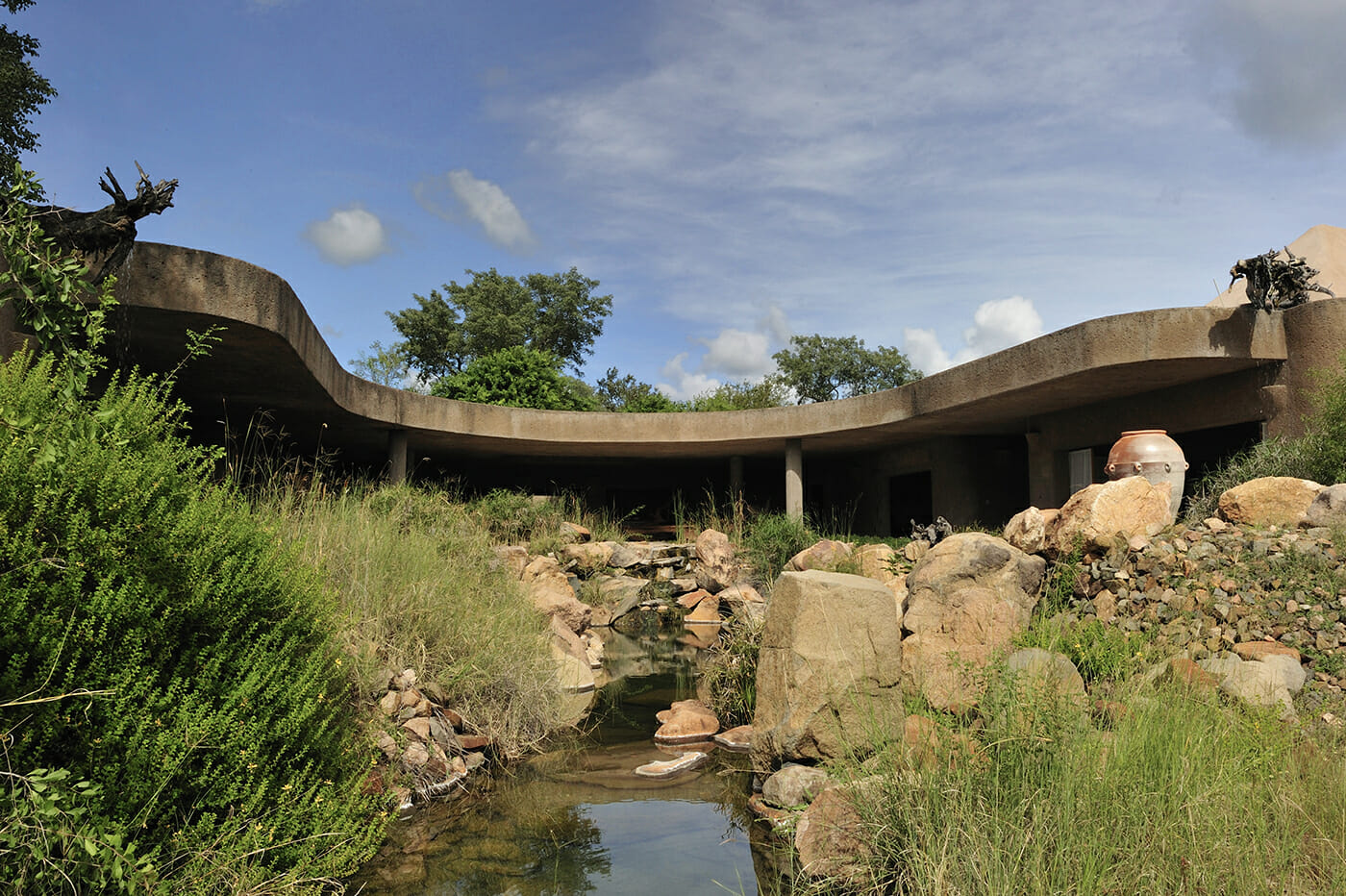 The beautiful entrance to Earth Lodge with a water feature. Photo courtesy of Sabi Sabi Earth Lodge
