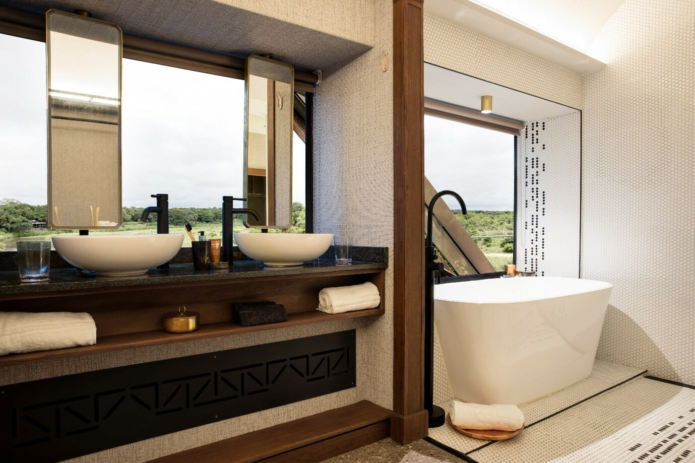 Each room has a full bathroom, with double vanities, a freestanding bath, and a shower. Photo courtesy of Kruger Shalati