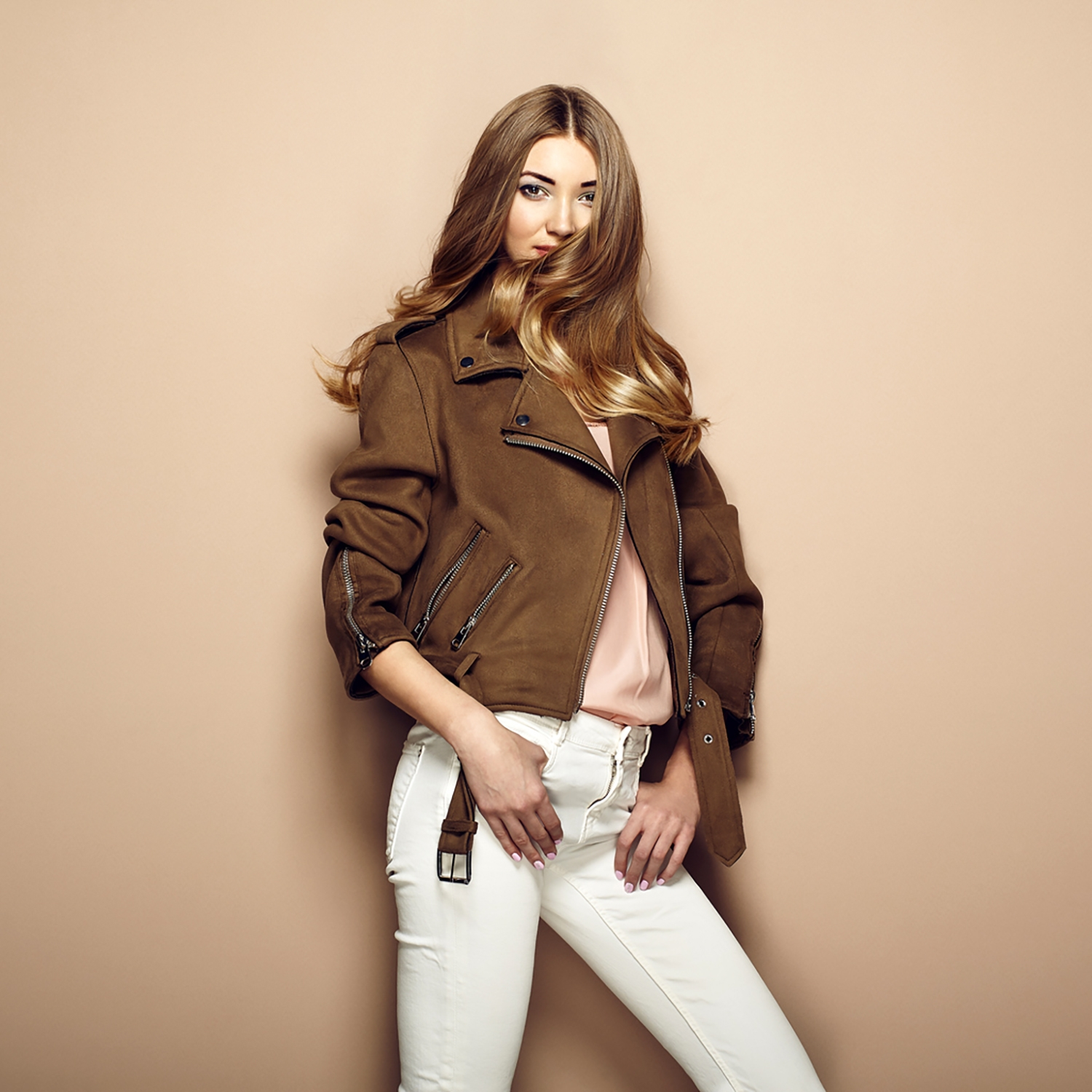 Beautiful woman wearing a brown leather jacket